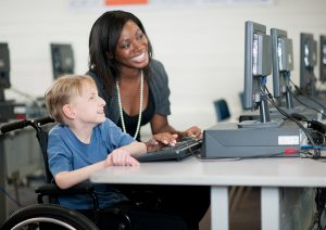 Paraprofessional with sensory disability student